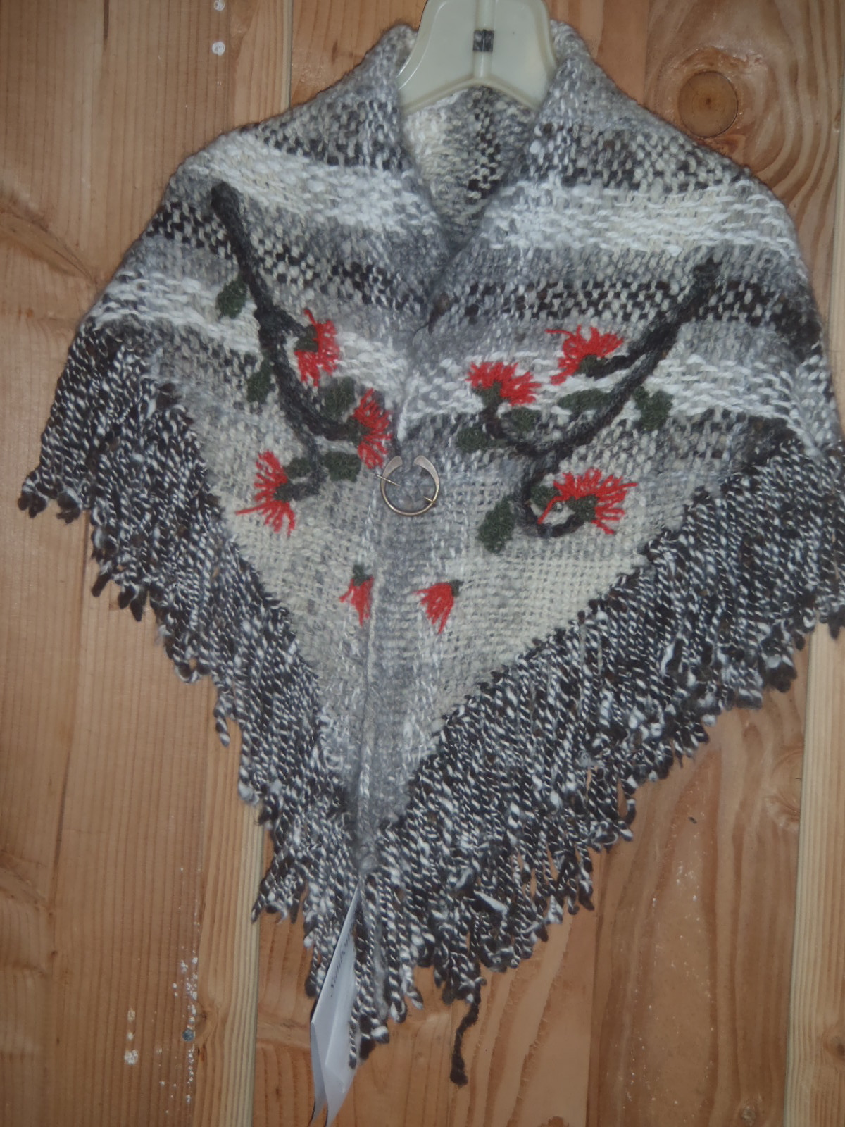 Shawl with embroider ohia blossoms.