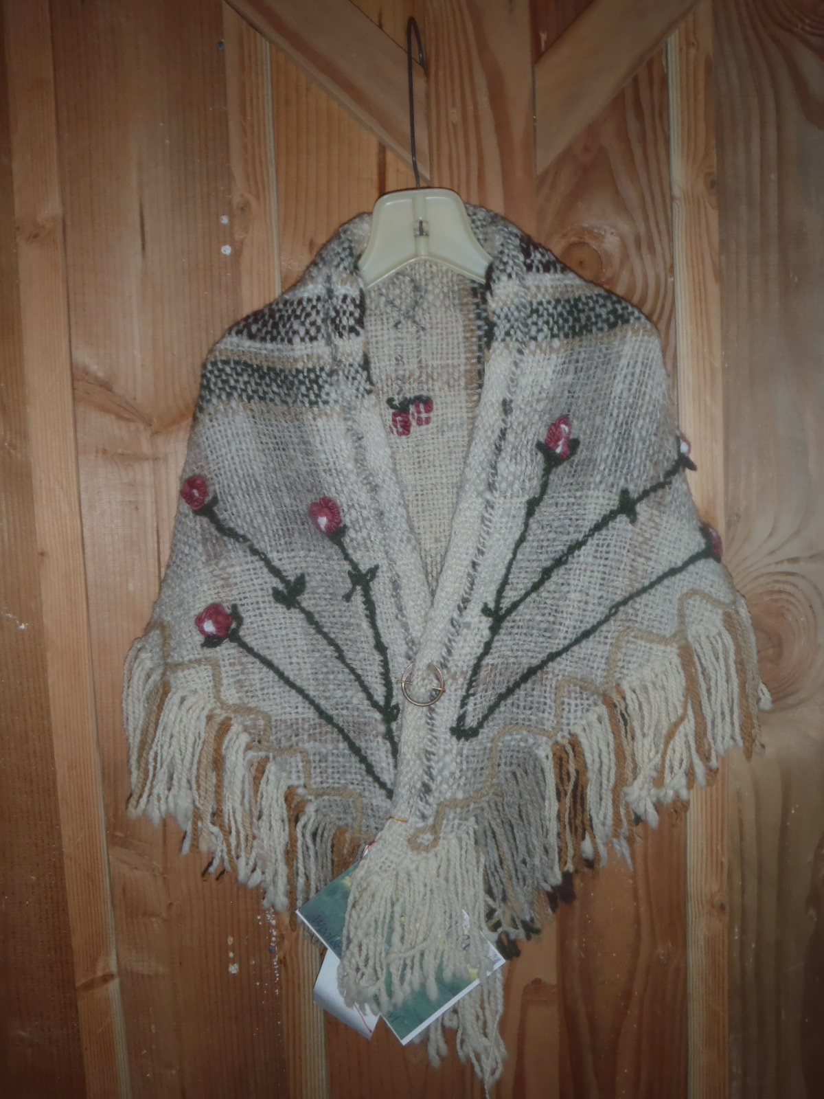 Embroidered rose bud shawl.